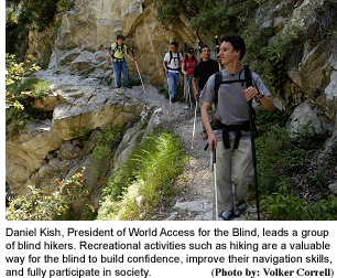 Daniel leads group hike with photo credit